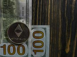 Silver Ethereum on US dollars. Digital currency photo