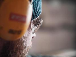 close-up of a carpenter wearing safety goggles and headphones photo