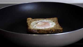 French Toast With An Egg Inside In A Pan. Traditional French Dish photo