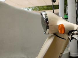 retro scooter outdoors closeup. headlight scooter. moped photo