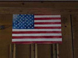 picture of american flag hanging on a wooden wall photo