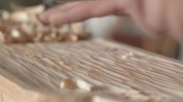 a woodcarver processes a pine wood board with a chisel video