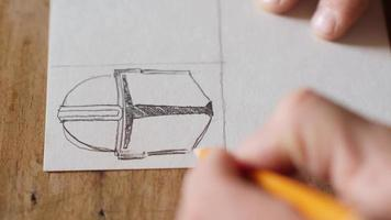 The artist makes a sketch on a piece of paper video