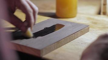applying oil on a wooden oak board with a sponge video