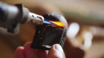 carpenter burns a piece of wood with a gas burner video