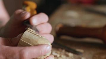 woodcarver carves a helmet of a robot or a knight video