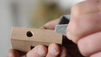 carpenter removes chamfer from a piece of wood with a small plane video