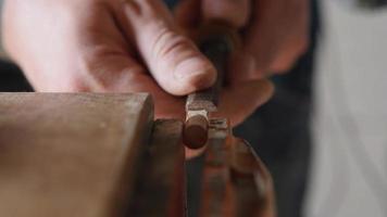 carpenter carves wood plug. video