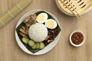 Flat lay traditional nasi lemak meal assortment photo