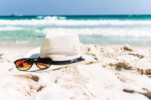 Close up straw hat and sunglasses photo