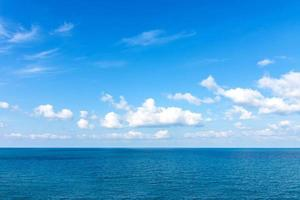 Ocean sea and cloud blue sky background photo