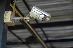 Old Security CCTV camera in building photo