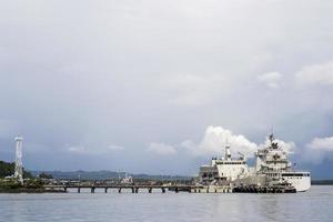 Battleship at naval dock photo