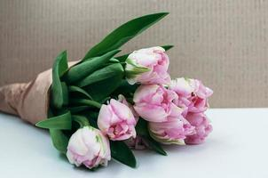 Closeup view of a bouquet of flowers on white background photo