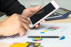 Asian accountant working with mobile phone in office photo