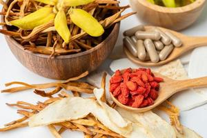 Chinese herb medicine with goji berries for good healthy. photo