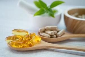 Alternative medicine herbal organic capsule with vitamin E photo