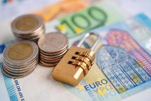 Golden security digital password lock key with Euro banknotes photo