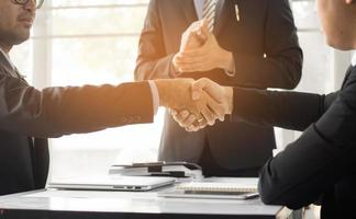 Business people shaking hand to cooperate photo
