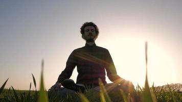Young Man Relaxing and Meditating in The Field video