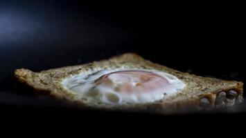 French Toast With An Egg Inside In A Pan photo