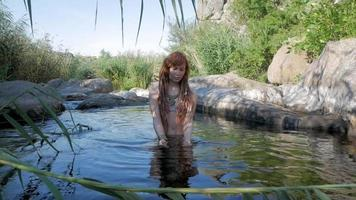 Young Woman Relaxing in A Mountain River video