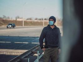 Man In A Medical Mask For Protection Against Flu Virus photo