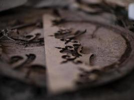 abstract wooden pattern on rusty iron cover on the ground photo