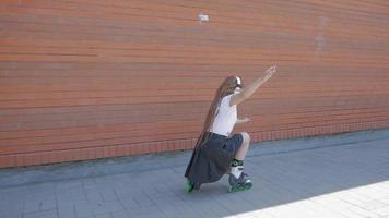 Young woman rollerblading with headphones video
