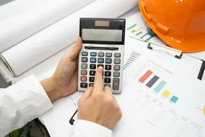 Asian accountant working and analyzing financial reports photo