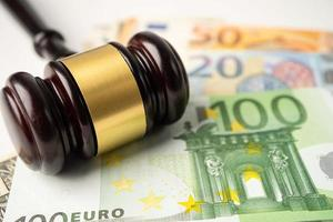 Gavel for judge lawyer on Euro banknotes background. photo