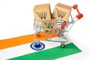 caja con el logotipo del carrito de la compra y la bandera de la india, i foto