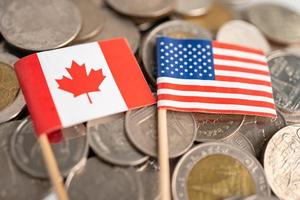 Stack of coins with USA America and Canada flag, finance concept. photo