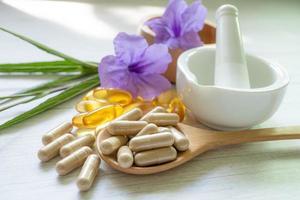 Alternative medicine herbal organic capsule with vitamin E omega 3 photo