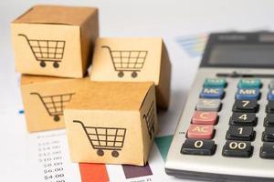 Shopping cart logo on box with calculator photo