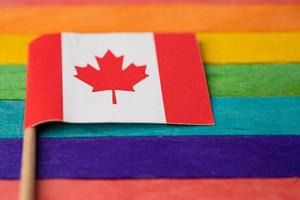 Canada flag on rainbow background symbol of LGBT gay pride month photo