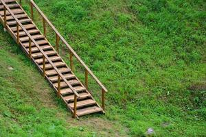 Wooden ladder for climbing the mountain photo