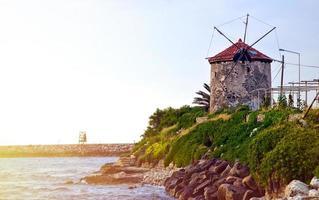 An Ancient Wind Mill Near the Sea photo