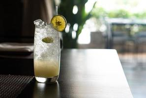 Iced lime soda in the glass on the table in the restaurant photo