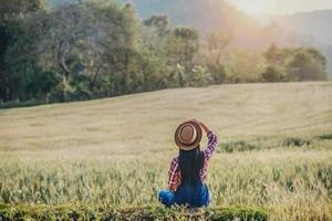 Woman farmer with barley field harvesting season photo
