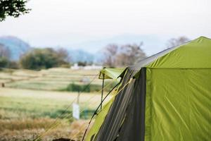 Tourist tent in camp in the mountain photo