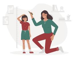 Mother measures the child height in the room vector