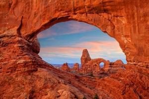 Turret arch through the North Window in Arches National Park in Utah photo