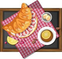 Breakfast croissant sandwich with a cup of lemon tea on a wooden plate vector