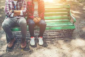 Young teenagers couple in love sitting together on the bench photo