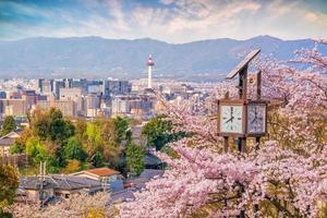 Kyoto city skyline with sakura photo