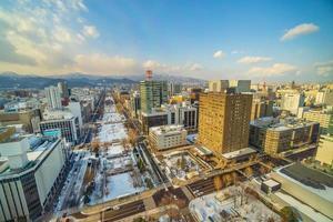 Sapporo city downtown skyline cityscape of Japan sunset photo