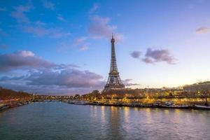 The Eiffel Tower and river Seine at twilight in Paris photo