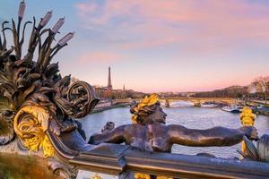 The Alexander III Bridge across Seine river in Paris photo