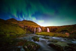 Landscape of mountain and waterfall in Iceland photo